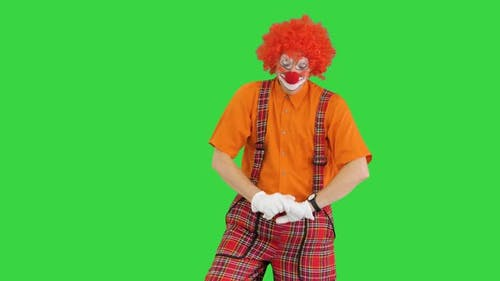 Male Clown Yawning and Doing Some Exercise in the Morning on a Green Screen Chroma Key