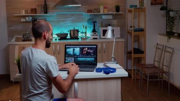 Filmmaker Editing Video Footage Using Modern Technology
