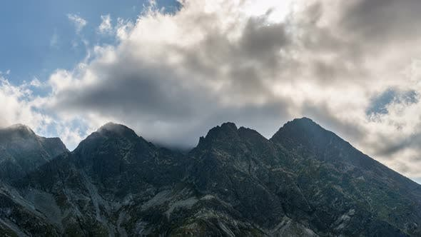 Thumbnail for Dramatic Clouds and Sunbeam over Alps Mountains Peak Getting Dark in Sunny Summer