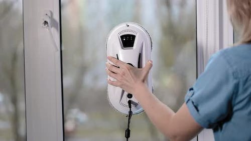 A Beautiful Housewife Installs a Cleaner Robot