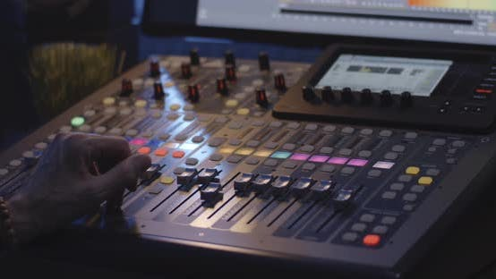 Thumbnail for Sound Engineer Operating Mixing Console