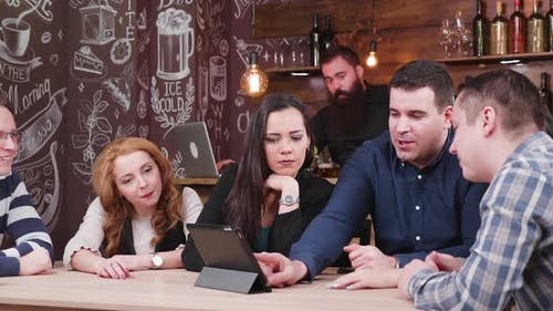 Group of Friends in Pub Choosing What To Order