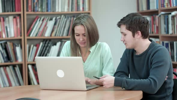 Thumbnail for Two Students Studying Together Using Laptop