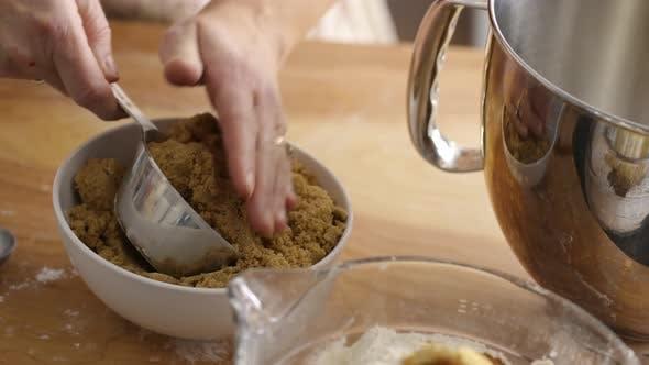 Measuring brown sugar for baking