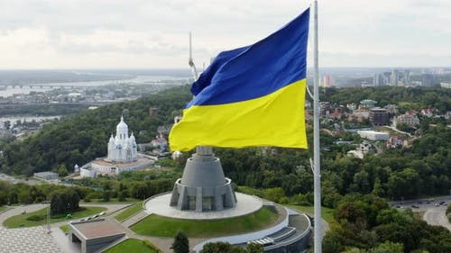 Aerial Top View of Kiev Motherland Statue Monument and National Ukrainian Flag Fluttering on