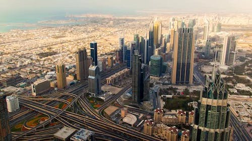 Dubai Panorama of Big Highway Intersection with Heavy Traffic and Tall Skyscrapers Time-lapse