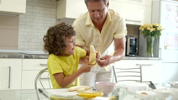 Thumbnail for Grandfather and Grandson Make Dessert Together, Boy Helping Grandpa on Kitchen
