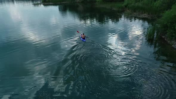 Thumbnail for Man Kayaking On Basalt Quarry Lake