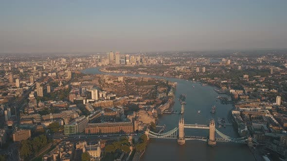Thumbnail for Wide view over London Cityscape at Sunset or Sunrise with Thames River and Tower Bridge, Aerial Pers