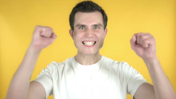 Thumbnail for Slow Motion of Man Celebrating Success, Yellow Background