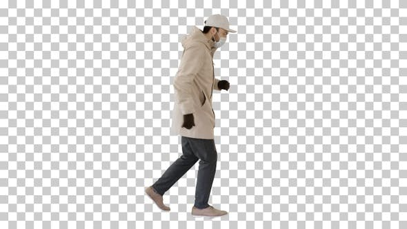 Thumbnail for Young man in outdoor clothes and medical mask jogging