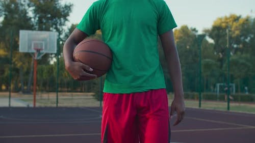 Midsection of Athlete with Basketball on Outdoor Court