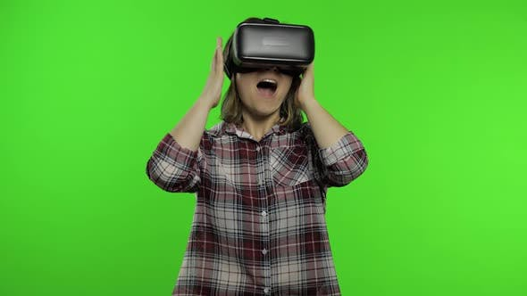 Thumbnail for Young Girl Using VR App Helmet To Play Simulation Game. Woman Watching Virtual Reality 3d Video