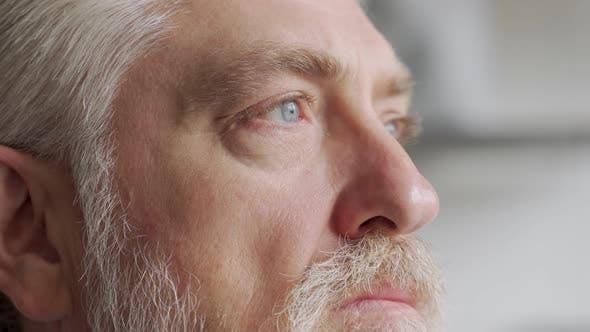 Old Man's Eyes Closeup Footage: Pensive Old Man Thoughtful Elder