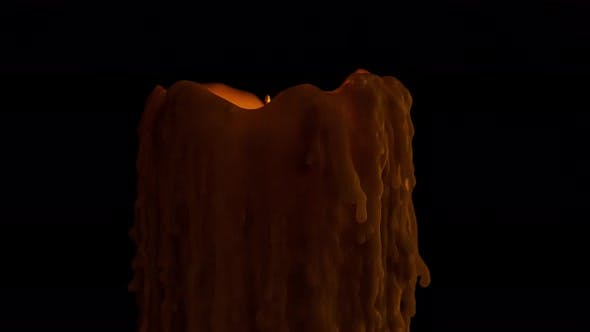 Time lapse of an old candle dripping wax as it burns