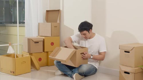 Excited guy opening unpacking cardboard boxes and easy and fast service commerce delivery.