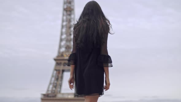 Parisian Woman Near the Eiffel Tower in Paris, France