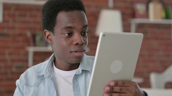 Thumbnail for African Man Doing Video Chat on Tablet