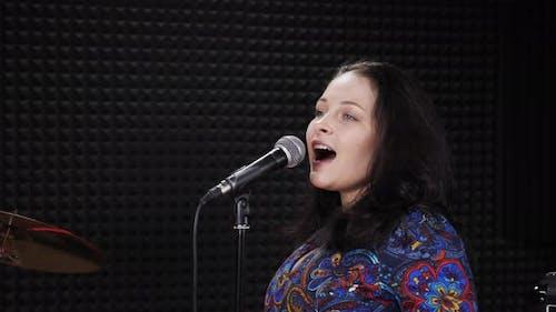 Woman is singing happy fun jazz song