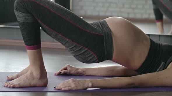 Thumbnail for Pregnant Woman Practicing Yoga Bridge Pose