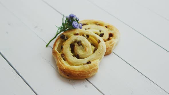 Thumbnail for Delicious Pastry with Raisins on White Wooden Table