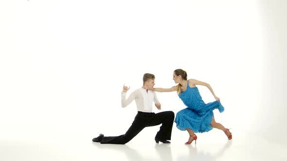 Thumbnail for Pair of Graceful Dancers Perform Tango on White Studio Background