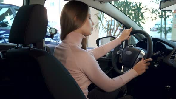 Thumbnail for Woman Shows Thumb Up Inside the Car