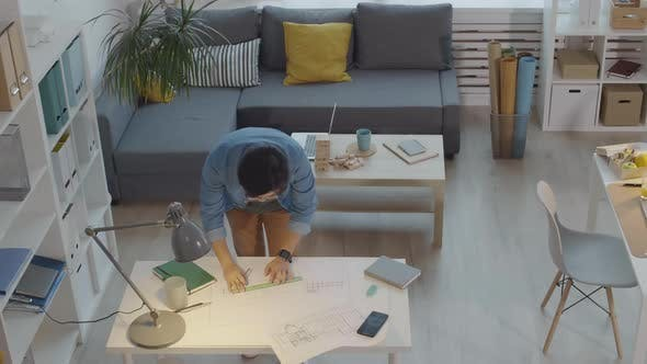 Stressed Male Architect Drawing Paper Plan and Throwing It Away