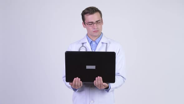Thumbnail for Young Happy Handsome Man Doctor Using Laptop