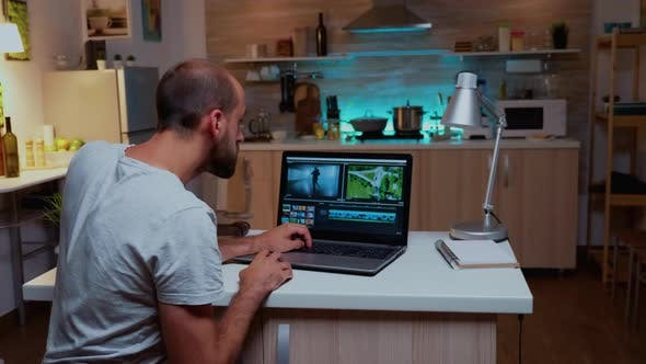 Content Creator Working on Laptop During Night Time