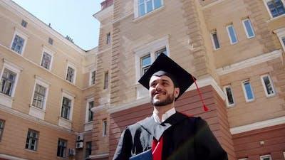Happy Graduate Student Walking Near College or University.