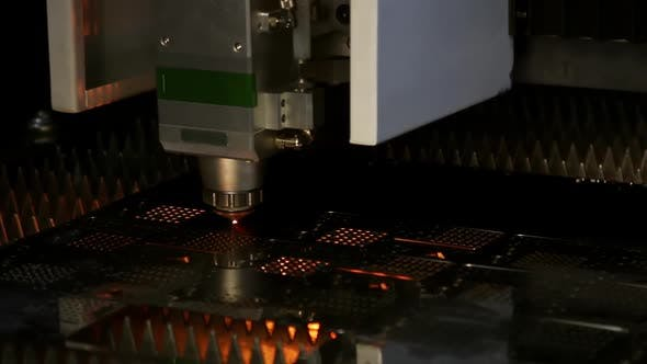 Laser Cutting and Metal Sparks Processing on a CNC Machine