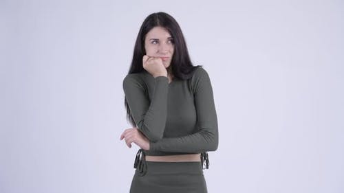 Serious Young Woman Thinking and Looking Down