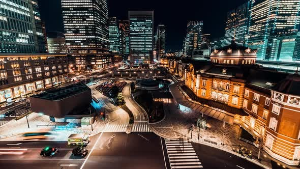 Thumbnail for Time-Lapse of Car Traffic at Tokyo Station at Night with Japanese People Crossing Roads