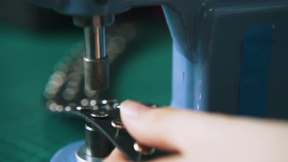 Professional Designer Fixes Metal Accessories on Choker