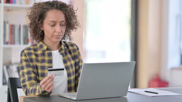 Online Shopping Success on Laptop By Young Mixed Race Woman