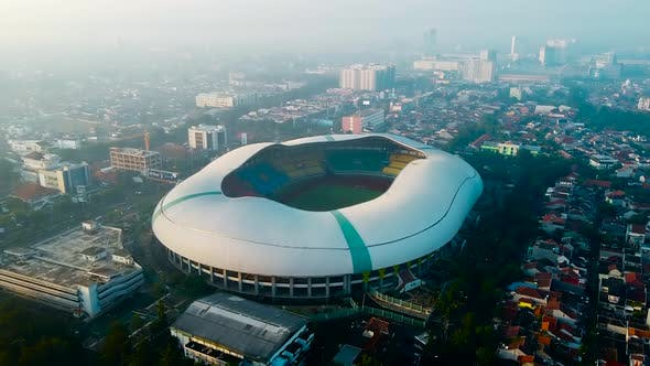 Thumbnail for Aerial View - The largest stadium looks from drone. With smog pollution