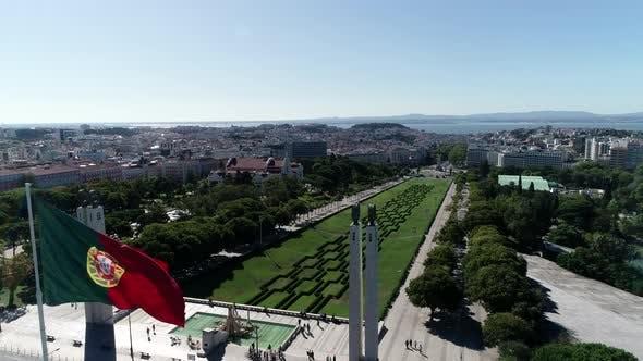 Thumbnail for Portuguese Waving Flag In Eduardo VII Park In Lisbon, Portugal Aerial View