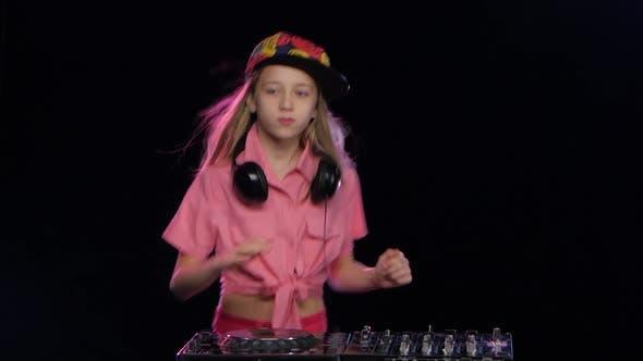 Thumbnail for Teenage Girl Plays Music and Dances at Dj Table. Studio