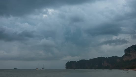 Cover Image for Time Lapse of Rain Clouds Over Beach and Sea Landscape with Boats. Tropical Storm in Ocean.