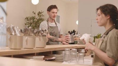 Female Bartender Polishing Cutlery