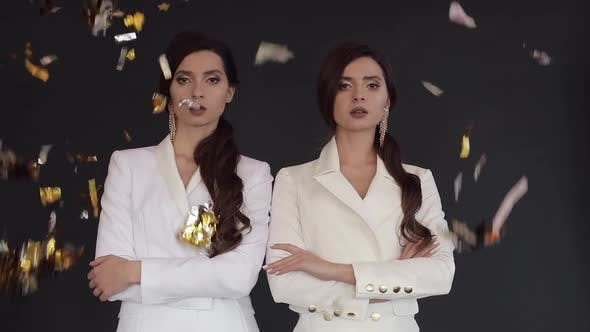 Thumbnail for Female Twins in White Suits Posing While Confetti Falling