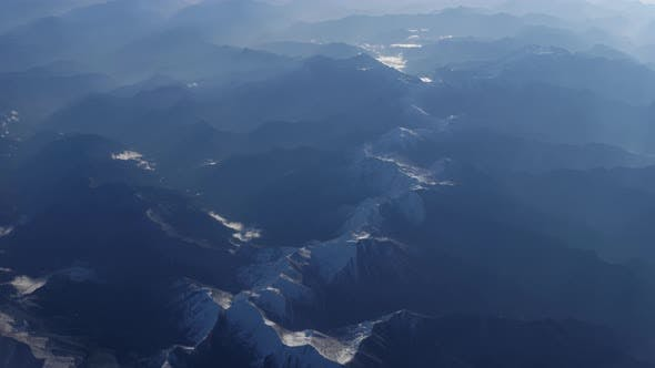 Thumbnail for Beautiful View Through Airplane Window, Airplane Flying Above River in Mountains