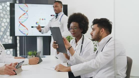 Thumbnail for Doctors Discussing Results of Patient's Examination During Joint Conference