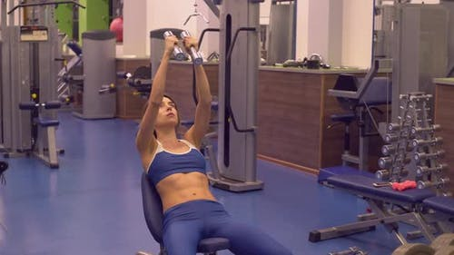 Caucasian Girl Trains with Dumbbells