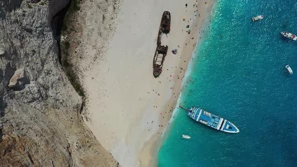 View of Navagio beach, Zakynthos Island, Greece. Aerial landscape. Blue sea water.