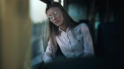 Worried Young Woman is Traveling Inside of a Bus
