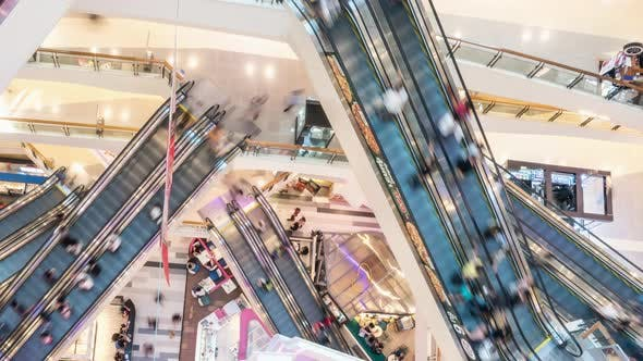 Thumbnail for Top view time lapse of crowded Asian people using escalators in modern shopping mall