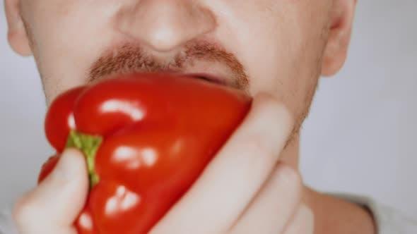 Thumbnail for Close Up Face Fair Man Eats Bell Pepper