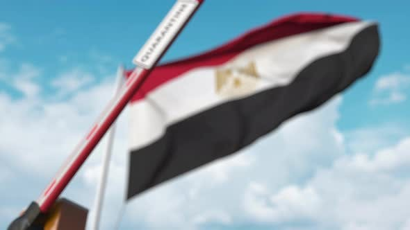 Thumbnail for Closing Boom Barrier with QUARANTINE Sign Near the Egyptian Flag